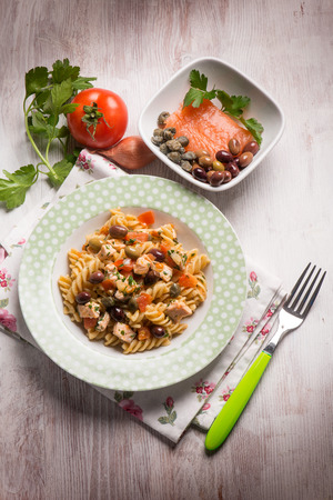 salmon dinner: pasta with fresh salmon tomatoes capers and olives
