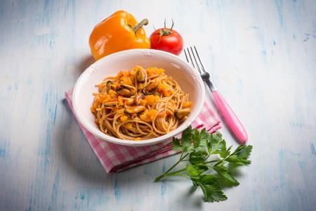 capsicums: pasta with mussel capsicum and tomato sauce Stock Photo