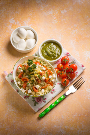 couscous: vegetarian couscous with mozzarella tomatoes and pesto sauce