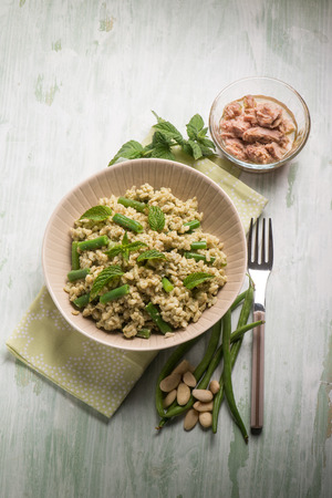 tuna salad: cold rice salad with tuna greenbeans almond and mint Stock Photo