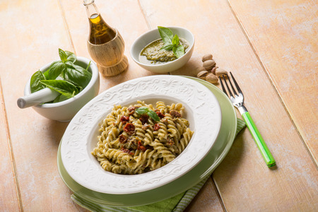 dried leaf: pasta with pesto pistachio and dried tomato