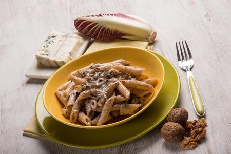 walnut: pasta with red chicory gongorzola and walnuts Stock Photo
