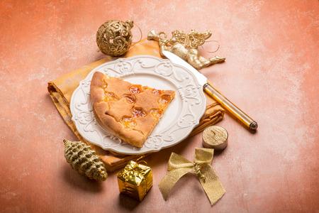 slice of cake: Slice cake over chrismas decorated table Stock Photo