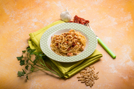 dried fish: spaghetti with swordfish ragout pine nut and dried tomatoes