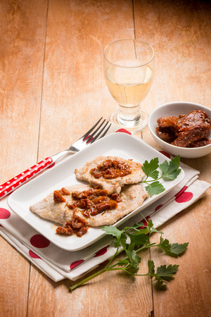 wine sauce: escalope with white wine and dried tomato