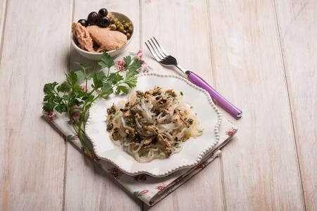 spaghetti shirataki with tuna black olives and capers Stock Photo