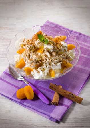 sliced: apricot dessert with sliced almond and cinnamon Stock Photo