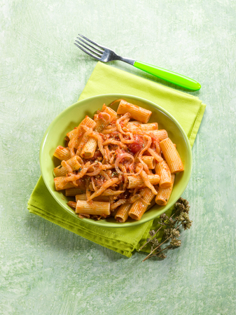 sicilian: pasta with eggplants and pachino tomatoes Stock Photo