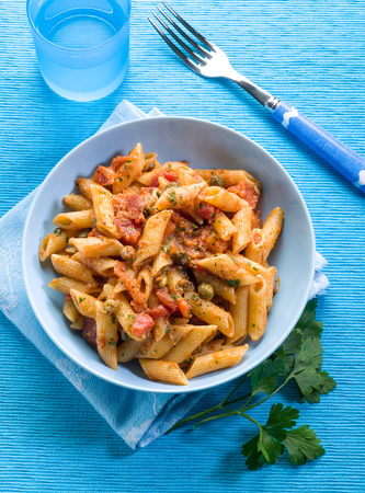 anchovy fish: pasta with anchovies capers and tomatoes Stock Photo