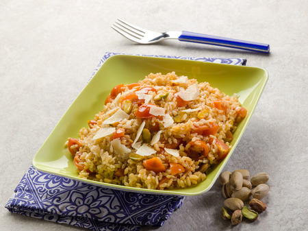 exotically: risotto with fresh tomatoes and pistachio nut Stock Photo