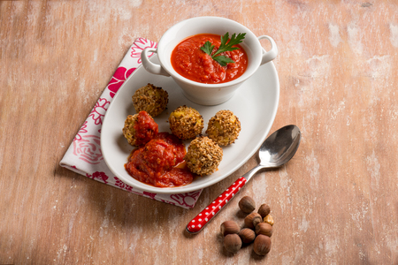 millet: maize vegetarian meatball with tomatoes sauce