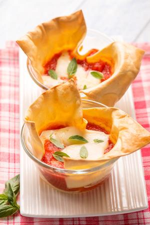 delicious food: creative little lasagne on glass bowl,  selective focus