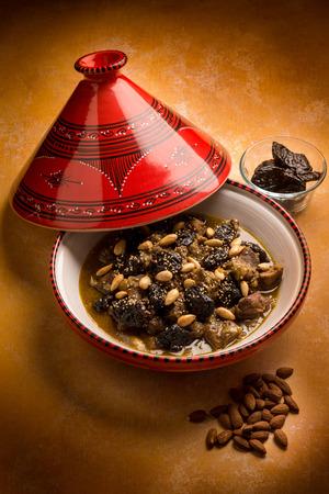 moroccan cuisine: tajine with meat plum almond and sesame seeds