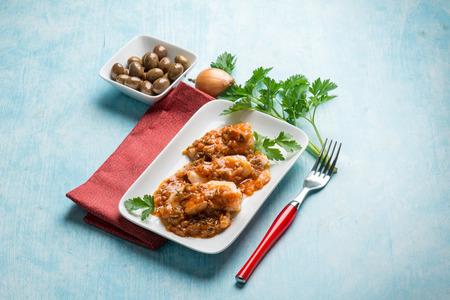 cod oil: cod fillet with  olives and  tomatoes sauce