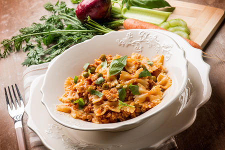 ragout: butterfly pasta with ragout sauce and green peas