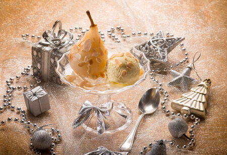 christmas table: ice cream and pear over christmas table Stock Photo