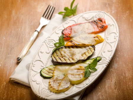 mixed vegetables grilled with scamorza cheese,  selective focus Stock Photo
