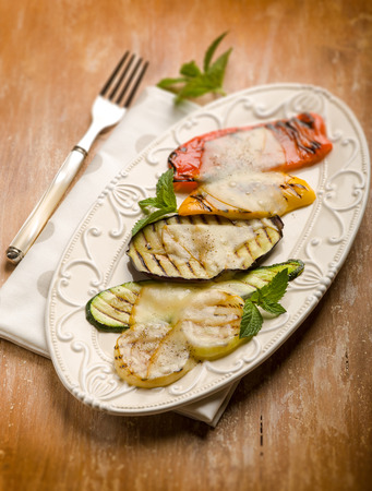 scamorza cheese: mixed vegetables grilled with scamorza cheese,  selective focus Stock Photo