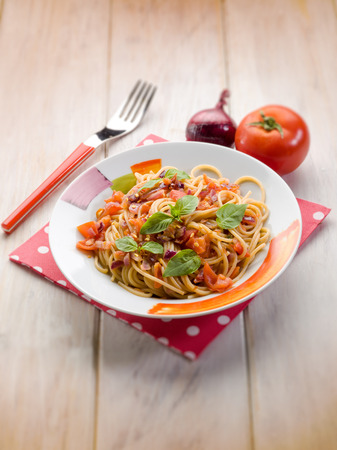 sauce dish: spaghetti with fresh tomato red onion and hot chili pepper, selective focus
