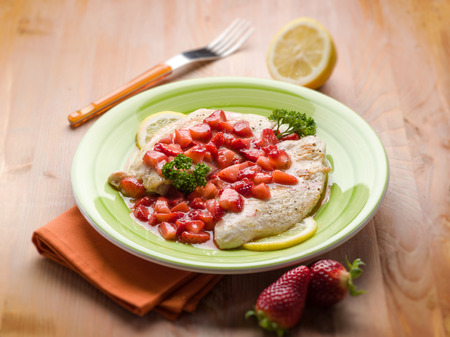 italian cusine: escalope with strawberries, selective focus Stock Photo
