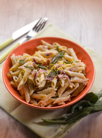 speck: pasta with speck sage and cream sauce, selective focus