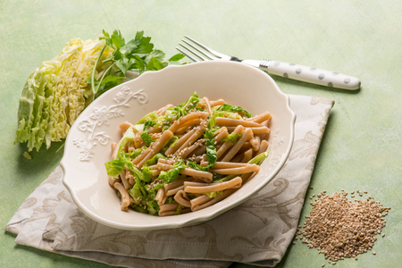 integral pasta with savoy cabbage and sesame seed