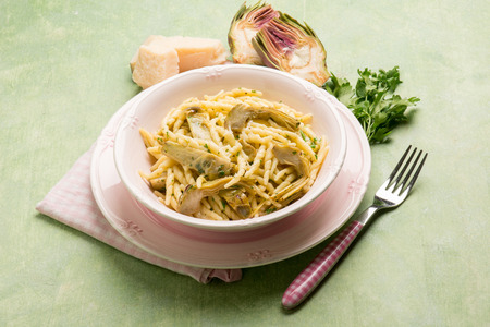 trofie pasta with artichoke and parmesan cheese Stock Photo