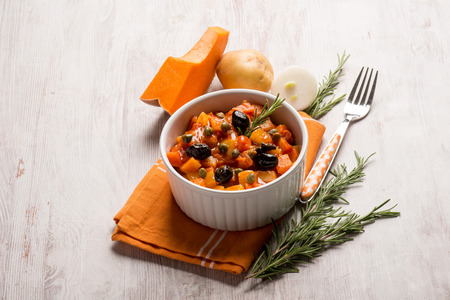 caper: ratatouille with pumpkin capers potatoes and black olives Stock Photo