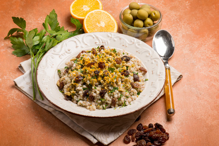 frutos secos: barley risotto with dried grape green olives and grated orange peel