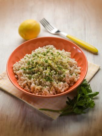 cebada: barley risotto with lemon peel and pepper, selective focus