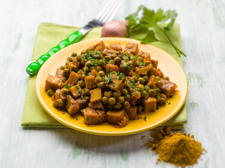 seitan stew with peas and curry, vegetarian food, selective focus