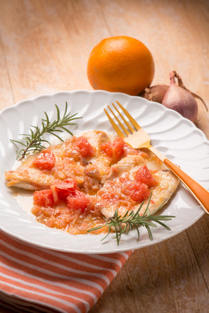 sauteed: escalope with shallot and grapefruit, selective focus