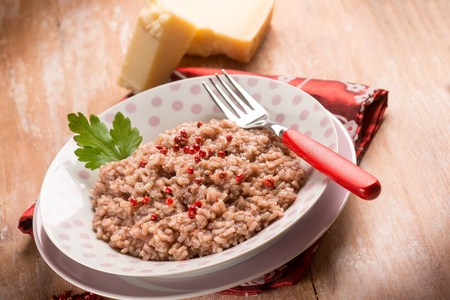 risotto with red wine red pepper and parmesan cheese, selective focus