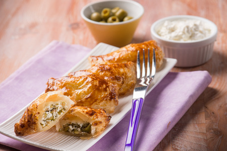 strudel: little strudel filled with ricotta and olives, selective focus