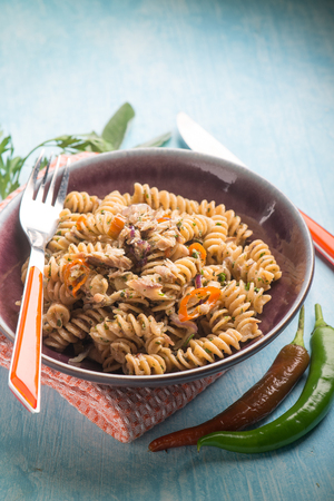 fusilli with fish and hot chili pepper, selective focus Stock Photo