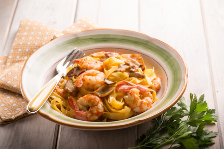 Tagliatelle with shrimp and porcino mushroom, selective focus