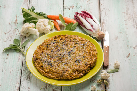 omelette with chicory cabbage carrot and sage Standard-Bild