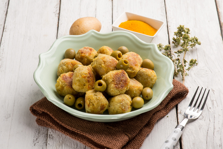 vegetarian meatballs with potatoes tumeric and green olives
