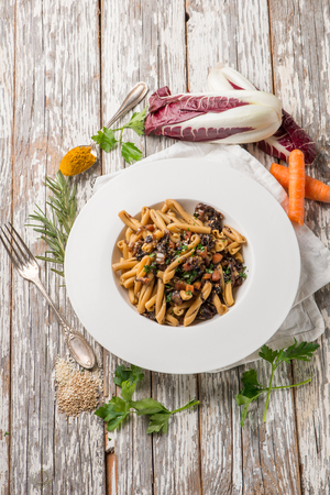 casarecce pasta with chicory chickpeas  sesame seeds and turmeric spice