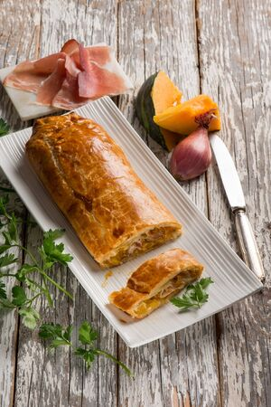 strudel puff pastry with parma ham and pumkin Stock Photo