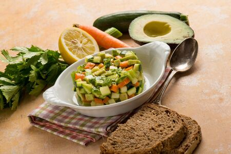 tartar salad with avocado carrots zucchinis and celery