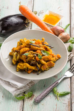 chicken stewed with eggpalnts carrots basil and turmeric spice