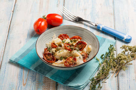 salad with baccala dried tomatoes and caper