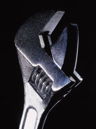 englishman:  A wrench on a black background.
