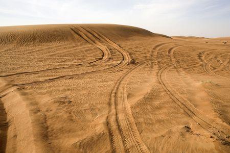 Landscape of Dubai desert with tracks of cars in UAE. photo