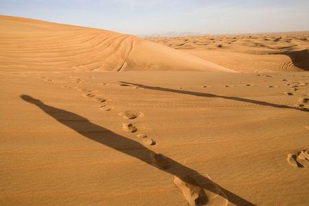 Landscape od Dubai desert with two human shadows. photo