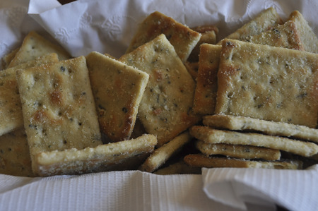 Crackers with seasoning in basket with white liner