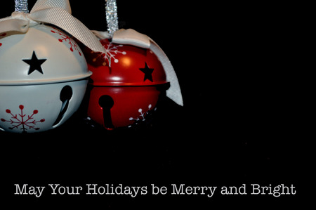 Christmas bell ornaments red and white with silver ribbon with May Your Holidays be Merry and Bright Stock Photo