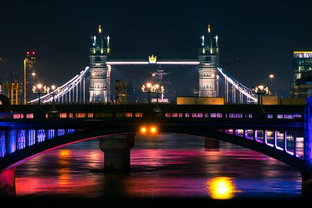 Magic light on river with Tower Bridge in night time