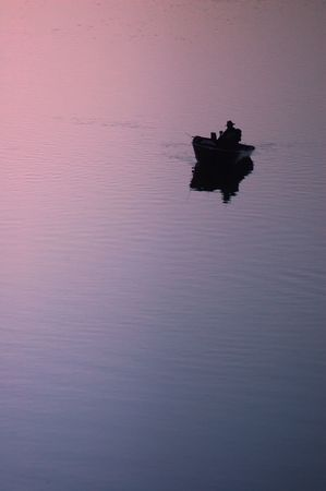 boater: Lone fisherman on river